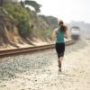 Female joggin next to railroad